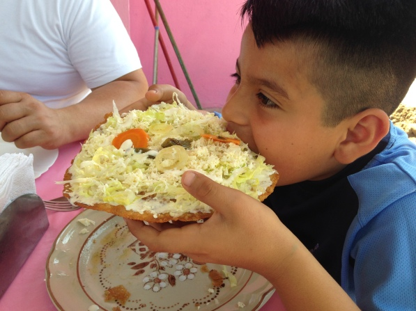 Nephew of Ben enjoying the day's special from Cocina de Rubi, Ben's Aunt's restaurant.