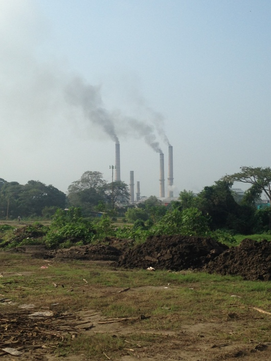The nearby sugar cane factory that processes the burned sugar cane into different sugars and syrups.